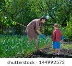 little boy helping his mother... | Shutterstock . vector #144992572
