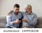 Old Father And Son Using Phone...