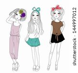 three fashion girls | Shutterstock .eps vector #144997012
