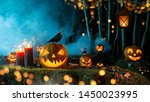 Stock photo halloween pumpkins on dark spooky forest with blue fog in background 1450023995