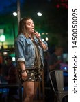 Young Vibrant Female Comedian...