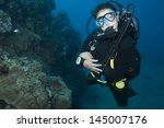 Woman Scuba Diver In Blue Ocean
