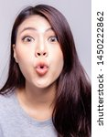 Small photo of Expression concept. Beautiful young woman kissing or making shorten mouth. Asian woman is playful woman. She looks funny. Charming beautiful young lady get happiness. She is joyful person