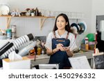 Stock photo asian women waiter hands on notebook taking customer orders in restaurant or cafeteria thai girl 1450296332