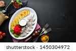 Stock photo herring with baked potatoes in the plate on a wooden background top view free space for your 1450304972