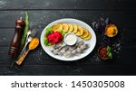 Stock photo herring with baked potatoes in the plate on a wooden background top view free space for your 1450305008