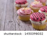 a few cupcakes on a wooden... | Shutterstock . vector #1450398032