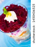 Stock photo verrin glass with delicious russian salad herring under fur coat from vegetables on blue plate 1450436525
