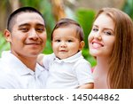 happy young family on babies... | Shutterstock . vector #145044862