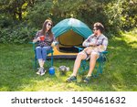 Stock photo people tourism and nature concept couple having fun on camping trip and play with cat 1450461632