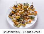 Stock photo salted herring on skewers with cheese and olives on plate 1450566935