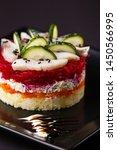 Stock photo russian salad herring under fur coat on a dark background 1450566995