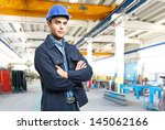 portrait of an engineer at work | Shutterstock . vector #145062166