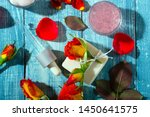 Stock photo beauty products with rose flowers and petals on blue wooden table background 1450641575