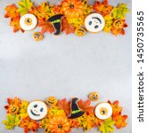 halloween background with... | Shutterstock . vector #1450735565