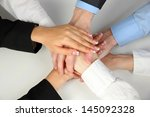 group of young people's hands... | Shutterstock . vector #145092328