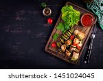 grilled meat skewers  chicken ... | Shutterstock . vector #1451024045