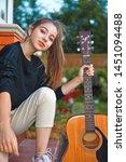 guitarist girl play music on... | Shutterstock . vector #1451094488