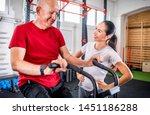 senior man biking at the gym...   Shutterstock . vector #1451186288
