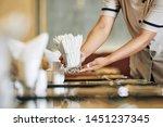 Close Up Of Waitress Setting...
