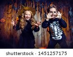 Stock photo portrait of a cute funny kids posing with pumpkins on a hay happy halloween 1451257175