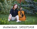 guitarist girl with guitar.... | Shutterstock . vector #1451371418