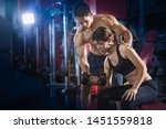 young woman exercise in a gym...   Shutterstock . vector #1451559818