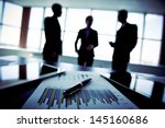 shadowy business trio holding a ... | Shutterstock . vector #145160686