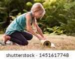 blond caucasian girl rolling...   Shutterstock . vector #1451617748