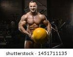 handsome athletic men pumping...   Shutterstock . vector #1451711135