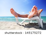 Young Man In White Cap Sunbath...