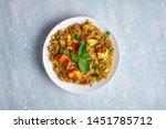 vegetarian paneer biryani at blue background. paneer biryani is traditional veg indian cuisine dish with paneer, basmati rice, masala, chili, mint. Copy space. isolated
