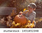 young european boy in stripy...   Shutterstock . vector #1451852348