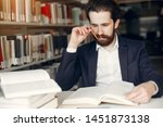 man in a library. guy in a... | Shutterstock . vector #1451873138