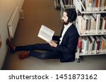 man in a library. guy in a... | Shutterstock . vector #1451873162