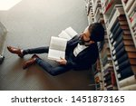 man in a library. guy in a... | Shutterstock . vector #1451873165
