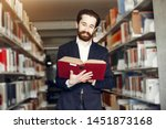 man in a library. guy in a... | Shutterstock . vector #1451873168