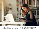 girl in a library. lady in a... | Shutterstock . vector #1451873852