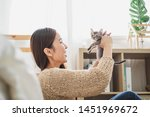 Stock photo young asian woman holding and playing with her cute kitten cat with lovely moment pet and human 1451969672