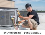 Hvac technician inspecting an...