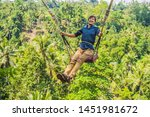young man swinging in the... | Shutterstock . vector #1451981672