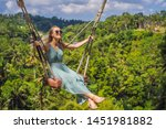 young woman swinging in the... | Shutterstock . vector #1451981882