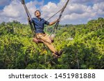 young man swinging in the... | Shutterstock . vector #1451981888