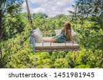young woman swinging in the... | Shutterstock . vector #1451981945