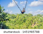 young woman swinging in the... | Shutterstock . vector #1451985788
