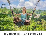young woman swinging in the... | Shutterstock . vector #1451986355