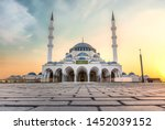 Small photo of Largest Mosque in Sharjah beautiful traditional Islamic architecture new tourist attraction Arabic Letter means:Indeed, prayer has been decreed upon the believers a decree of specified times