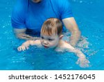 little boy learns to swim in...   Shutterstock . vector #1452176045
