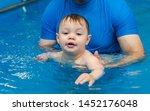little boy learns to swim in...   Shutterstock . vector #1452176048