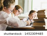 girl studying with friends at... | Shutterstock . vector #1452309485